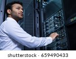 serious young man working with... | Shutterstock . vector #659490433