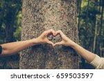 hands forming a heart shape... | Shutterstock . vector #659503597