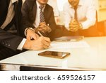 business partners signing... | Shutterstock . vector #659526157