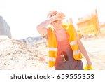 tired construction worker... | Shutterstock . vector #659555353