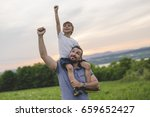 a father and son having fun... | Shutterstock . vector #659652427