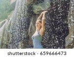 young woman relaxing under a... | Shutterstock . vector #659666473