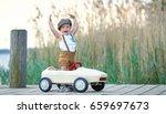 active little boy driving pedal ...   Shutterstock . vector #659697673