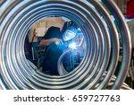 worker is welding metal tubes. | Shutterstock . vector #659727763