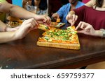 friends eating a square pizza... | Shutterstock . vector #659759377