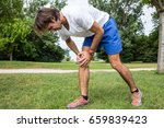 knee injury while jogging in... | Shutterstock . vector #659839423