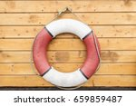 Lifebuoy Hanging On A Wooden...
