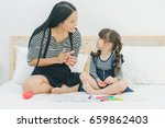 a little cute girl enjoy... | Shutterstock . vector #659862403