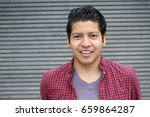 joyful ethnic male smiling... | Shutterstock . vector #659864287