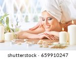 young woman having massage | Shutterstock . vector #659910247