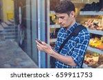 man traveler looking at his... | Shutterstock . vector #659911753