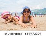 little girls  lying on a sandy... | Shutterstock . vector #659973307