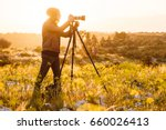 portrait of young photographer... | Shutterstock . vector #660026413