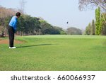 man playing golf on a golf... | Shutterstock . vector #660066937