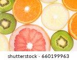 sliced fruits background  | Shutterstock . vector #660199963