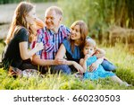 happy family of four siting on... | Shutterstock . vector #660230503