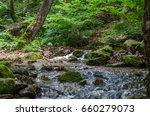 tiny river cascade waterfall... | Shutterstock . vector #660279073