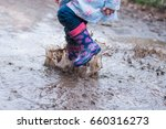 child jumping in the muddy...   Shutterstock . vector #660316273