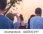 tourists watching the sunset... | Shutterstock . vector #660332197