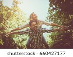 boyfriend carries the girl on... | Shutterstock . vector #660427177