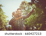 single father on meadow with... | Shutterstock . vector #660427213