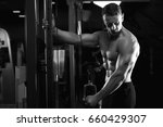 male fitness model working out... | Shutterstock . vector #660429307