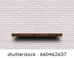 empty wooden shelf on old white ... | Shutterstock . vector #660462637