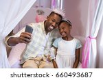 happy father and daughter... | Shutterstock . vector #660493687
