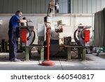 worker prepares metal parts for ... | Shutterstock . vector #660540817