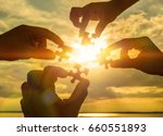 collaborate four hands trying... | Shutterstock . vector #660551893