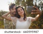 beautiful young woman taking... | Shutterstock . vector #660595987