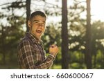 Small photo of Young man celebrate the attainment in the forest outdoor