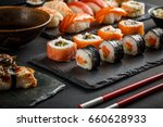 various kinds of sushi served... | Shutterstock . vector #660628933