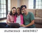 portrait of family using laptop ... | Shutterstock . vector #660654817