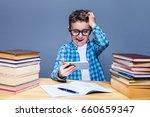 smart schoolboy doing homework...   Shutterstock . vector #660659347