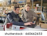 warehouse managers using laptop ... | Shutterstock . vector #660662653