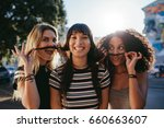 happy and smiling young women... | Shutterstock . vector #660663607