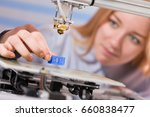 a female student or laboratory... | Shutterstock . vector #660838477