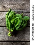 a bunch of spinach on a wooden...   Shutterstock . vector #660963187