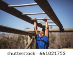 determined boy exercising on... | Shutterstock . vector #661021753