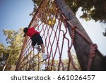 boy climbing a net during... | Shutterstock . vector #661026457