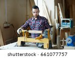 serious woodworker processing... | Shutterstock . vector #661077757