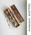 Small photo of The game with the multi - colored wooden sticks. mikado pick a stick