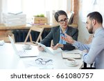 woman and her boss discussing... | Shutterstock . vector #661080757