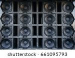 Small photo of Speakers collage, useful image in a musical composition. Wall of large black music speakers.