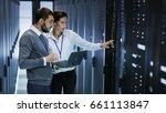 male it specialist holds laptop ... | Shutterstock . vector #661113847