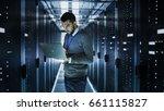 it technician works on a laptop ... | Shutterstock . vector #661115827
