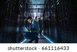 it technician works on laptop... | Shutterstock . vector #661116433