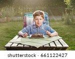 happy boy eating a steak in the ...   Shutterstock . vector #661122427