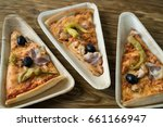 a slices of pizza is on a... | Shutterstock . vector #661166947